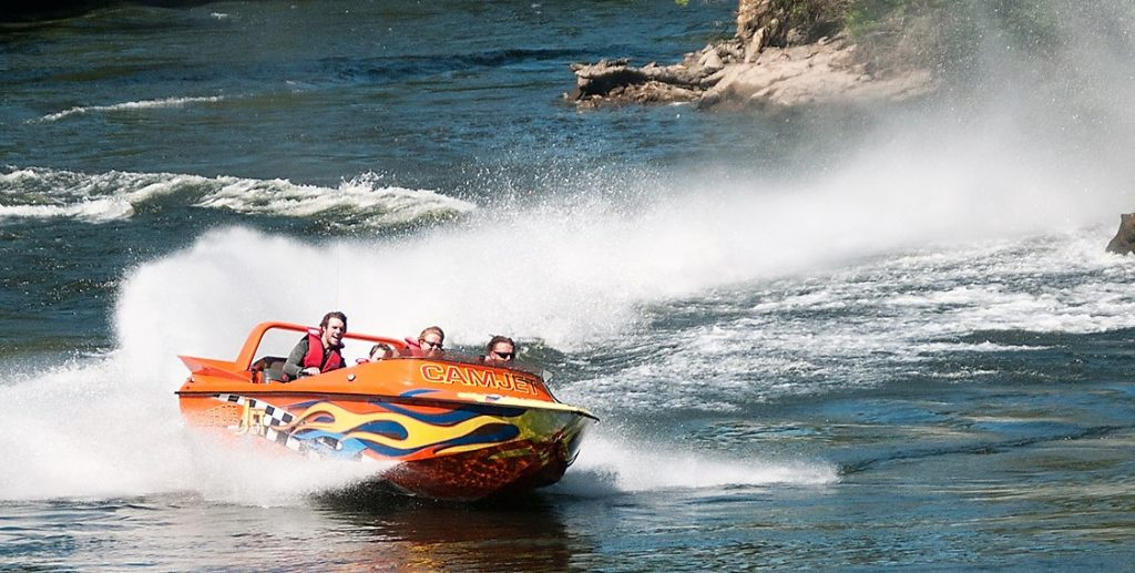 Camjet T2 jet boat doing turn Waikato river New Zealand. Things to do in Cambridge New Zealand