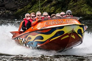 Jet boat NZ, with Camjet. Full boat load getting up on a plane.